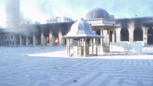 15 Oct. Fire burns after shelling at the Grand Umayyad mosque in Aleppo